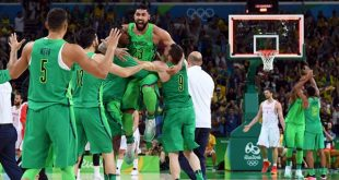 Brazil's centre Augusto Lima (C) celebrates with teammates after defeating Spain during a Men's round Group B basketball match between Spain and Brazil at the Carioca Arena 1 in Rio de Janeiro on August 9, 2016 during the Rio 2016 Olympic Games. / AFP / Mark RALSTON